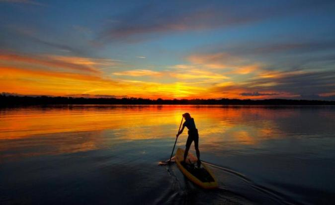sunset paddle boarding